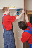 Wardrobe joiners at installation work Royalty Free Stock Image