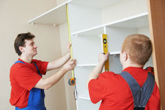 Wardrobe joiners at installation work Royalty Free Stock Images