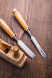 Two carpentry chisel and old fashioned woodworkers Stock Photography