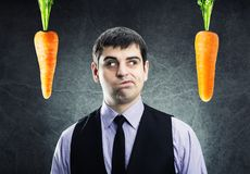 Two carrots and businessman Stock Photo
