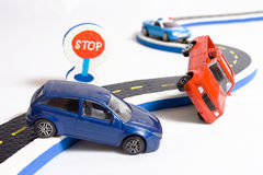 Two cars accident crash on road, broken toys auto car, insurance. Two cars accident crash on road and approaching police, insurance case, broken toys auto car Stock Images