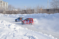 Two cars compete at the turning the track Royalty Free Stock Image