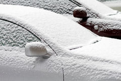 Two cars, covered with snow Royalty Free Stock Images