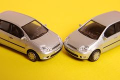 Two cars crash. Toy cars staying near each other Royalty Free Stock Images