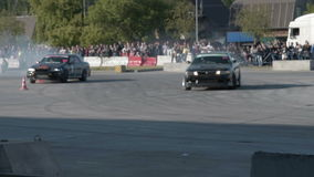 Two cars during drift challenge stock video footage