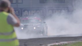 Two Cars Drifting with Smoke. Ryazan, Russia - September 1, 2016 : Slow motion shot of two cars drifting with lots of smoke during drift competition in Ryazan stock video footage
