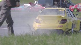Two Cars Drifting with Smoke. Ryazan, Russia - September 1, 2016 : Slow motion shot of two cars drifting with lots of smoke during drift competition in Ryazan stock footage
