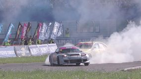 Two Cars Drifting with Smoke. Ryazan, Russia - September 1, 2016 : Slow motion shot of two cars drifting with lots of smoke during drift competition in Ryazan stock video