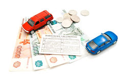 Two cars, driving license, coins and money Royalty Free Stock Images