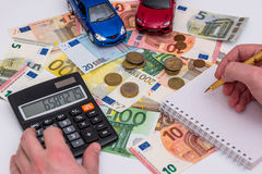 Two cars with euro bills Royalty Free Stock Images