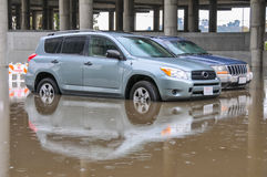 Two cars parked in deep water Stock Images