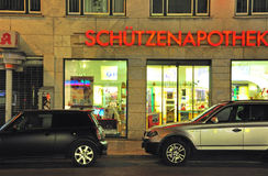Two cars parked on the street, Munchen, Germany Stock Photo