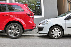 Two cars parked in the street. SAINT GERVAIS, FRANCE - AUGUST 13: Two cars parked in the street of Saint Gervais on August 13, 2015. Saint Gervais is a commune stock photos