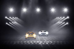 Two cars race track finish line racing royalty free stock images