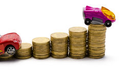 Two cars rise after coins Stock Image
