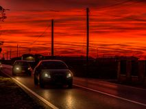 Two Cars On Road During Golden Hour Royalty Free Stock Photo
