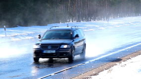 Two cars running fast on the road with snow. Two cars simultaneously running fast on the road with thick snow and pine trees on the roadside stock video
