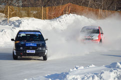 Two cars together on an input in turn track. RUSSIA SAMARA - FEBRUARY 12: Two cars compete at the turning the track, Cup of Russia in Speedway car on ice royalty free stock images