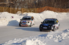 Two cars together on an input in turn track. RUSSIA SAMARA - FEBRUARY 12: Two cars compete at the turning the track, Cup of Russia in Speedway car on ice stock photo