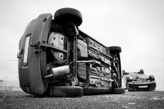 Two cars turned upside-down Stock Images
