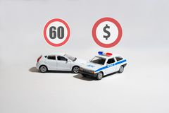 White car and police car and two signs above them. Two cars: the white car and police car and two signs above them Stock Photos