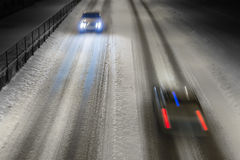 Two cars on winter road Royalty Free Stock Photos