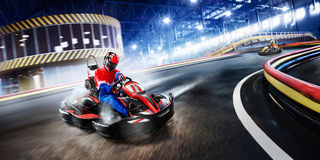 Two cart racers are racing on the grand track. Motion Royalty Free Stock Photo