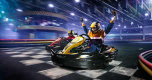 Two cart racers are racing on the grand track. Motion Royalty Free Stock Image