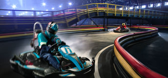 Two cart racers are racing on the grand track Stock Images