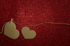 Two carton heart attached to the rope on shining background Royalty Free Stock Photos
