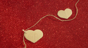 Two carton heart on the red shining background Royalty Free Stock Photography
