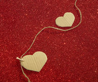 Two carton heart on the red shining background Royalty Free Stock Images