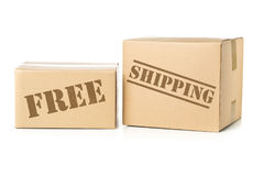 Two carton parcels with Free Shipping imprint. Two corrugated cardboard carton parcels with Free Shipping imprint royalty free stock photography