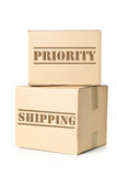 Two carton parcels with Priority Shipping imprint Stock Photos