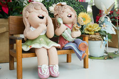 Two cartoon girls are smiling in the garden Stock Photo