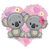 Two Cartoon Koalas on a background of heart Royalty Free Stock Images