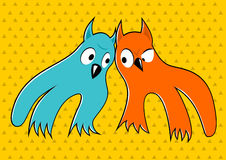 Two cartoon monsters looking at each other Stock Photo