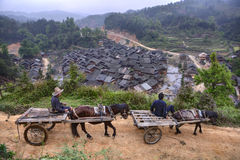 Two carts with Chinese peasants passing along mountain road, spr Royalty Free Stock Image