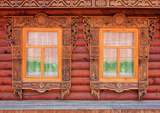 Two carved windows of old wooden house Stock Image