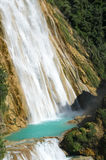 Two cascades of El Chiflong waterfall with turquoise pool between them stock images