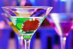 Two casino chips in the bar cocktail glass Royalty Free Stock Photography