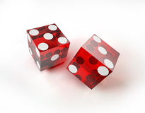Two casino red dices in action, on white surface. Stock Photo