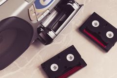 Two cassettes lying on a marble surface next to open music center. Retro style royalty free stock photos
