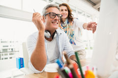 Two casual designers working with computer Royalty Free Stock Photo