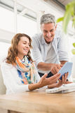 Two casual designers working with tablet Stock Photography