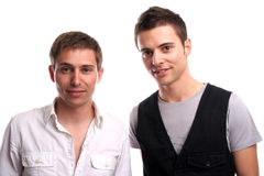 Two casual friends, posing. In white background stock photos