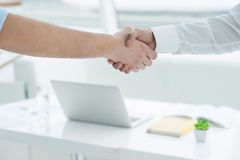 Two casual men shaking hands Royalty Free Stock Photos