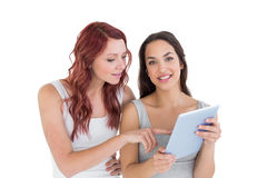 Two casual young female friends with digital tablet Royalty Free Stock Image
