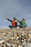 Two casual young men gesturing. At the beach stock photo