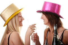 Two casual young women enjoying champagne Stock Photo